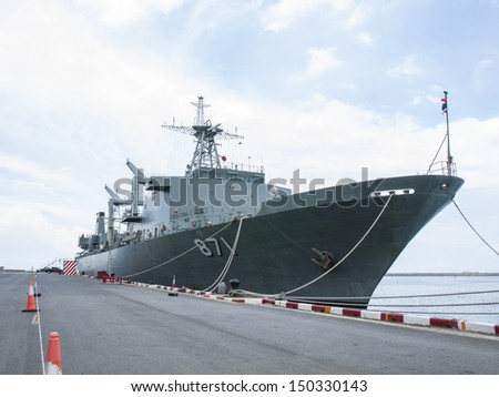 Battleship docked at the harbor. Bow with anchor - stock photo