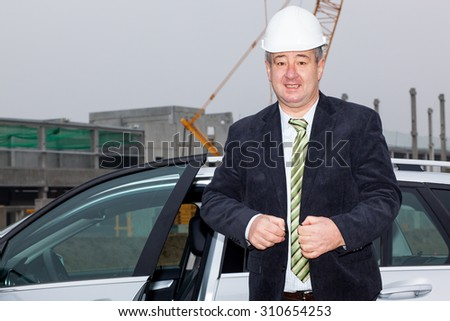 Bauingenier at construction site - stock photo