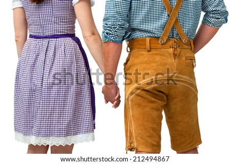 bavarian couple wearing traditional dress holding hands - stock photo