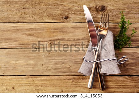 Bavarian cutlery on wooden table with copyspace for oktoberfest or other german festivals - stock photo