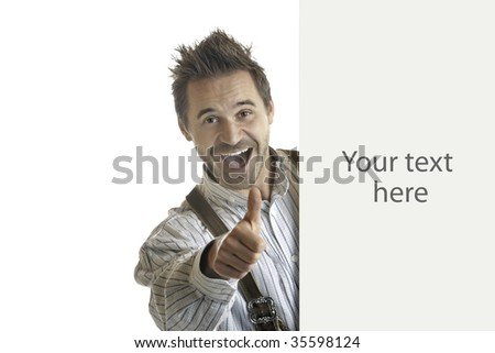 Bavarian man holding billboard with thumb up and shows an interesting offer/advertisement - stock photo