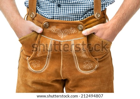 Bavarian man wearing traditional Leather Trousers with hands in pockets - stock photo