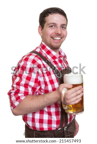 Bavarian man with leather pants showing drinking beer mug - stock photo