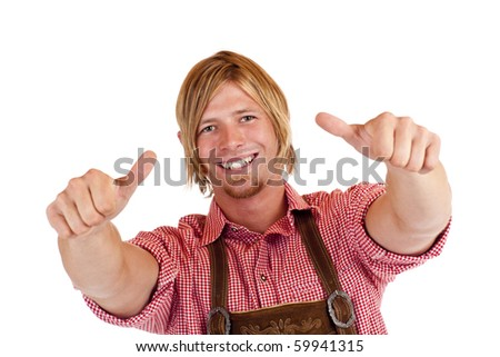 Bavarian man with oktoberfest leather trousers (Lederhose) shows both thumbs up.  Isolated on white background. - stock photo