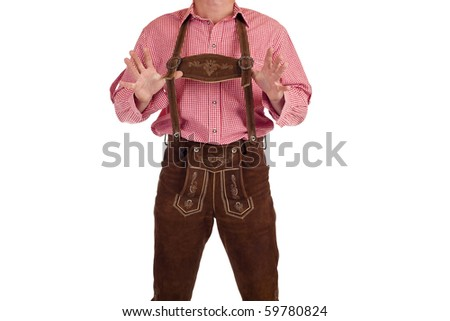 Bavarian man with oktoberfest leather trousers stands casual. Isolated on white background. - stock photo