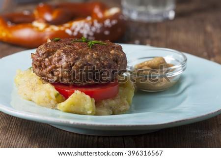 bavarian meat loaf and potato salad  - stock photo