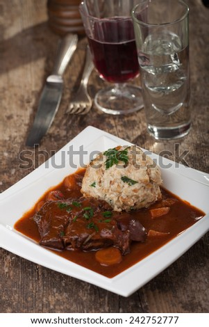 bavarian meat stew with dumpling  - stock photo