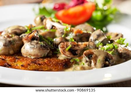bavarian mushroom sauce with hash browns - stock photo