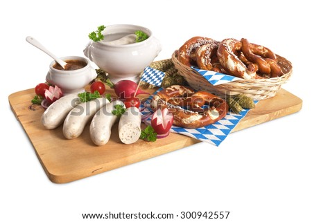 Bavarian veal sausage breakfast with sausages, soft pretzel and mild mustard on wooden board - stock photo