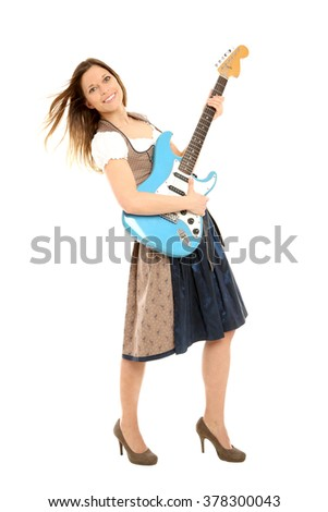 Bavarian woman with guitar - stock photo