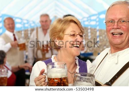 Bavarians drinking beer - stock photo