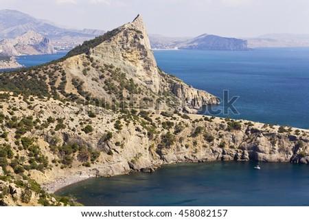 Bay and rocks of the New World.Black sea coast of Crimea. - stock photo