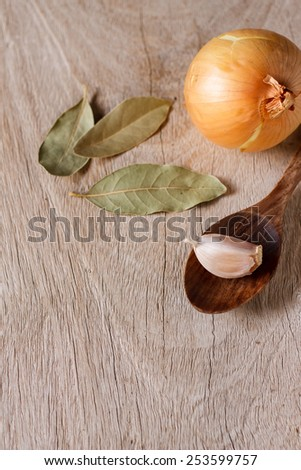 bay Leave and organic onion ingredient for cook put on old white wooden - stock photo