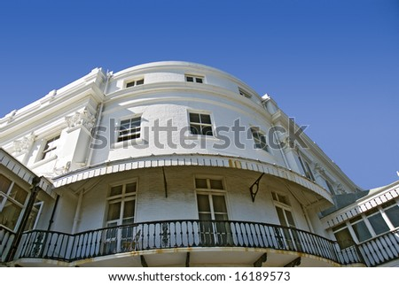 bay of English Regency house against brilliant clear summer sky - stock photo