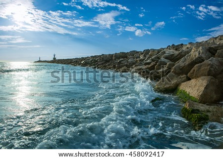 Bay on the coast at France with large rocks as a breakwater - stock photo