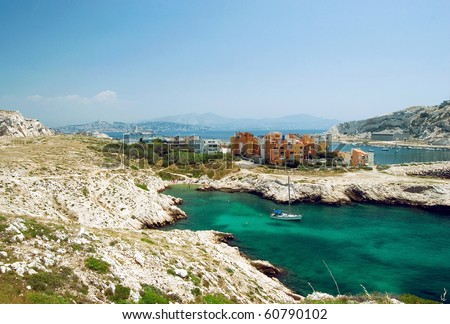 Bay on the island Frioul with look onto the Chateau dIf and on Marseille - stock photo