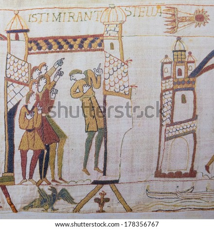 BAYEUX, FRANCE - FEB 12: Detail of the Bayeux Tapestry depicting the appearance of Comet Halley before the Norman invasion of England in the 11th Century on February 12, 2013. - stock photo