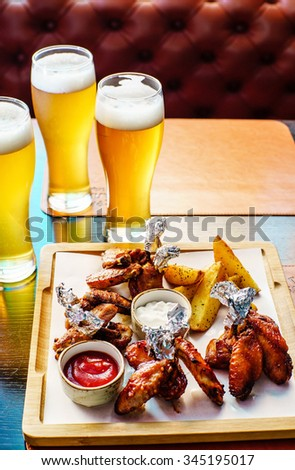 bbq buffalo wings with beer - stock photo