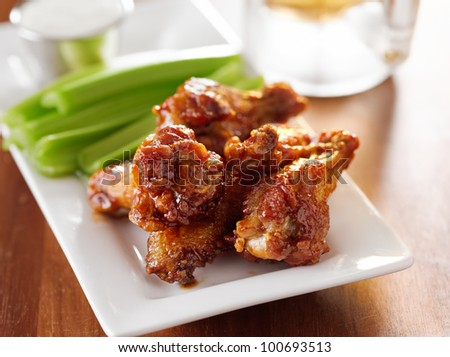 bbq buffalo wings with celery and ranch. - stock photo