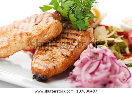 BBQ Chicken Breast on Grilled Vegetables with Lavash and Pickled Onions - stock photo