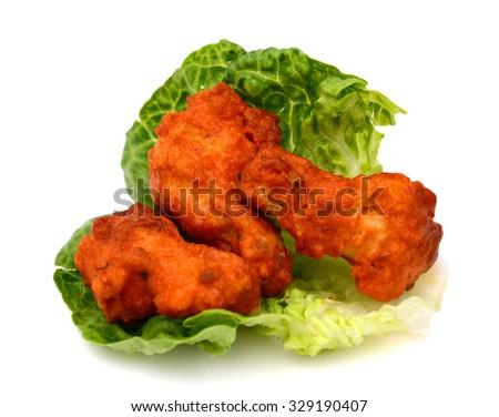 BBQ chicken in salad leaf - stock photo