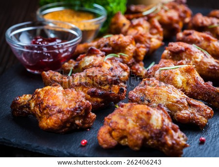 BBQ chicken wings with spices and dips - stock photo