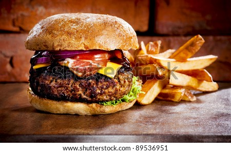 bbq hamburger on the stone table with cheese and serrano ham - stock photo