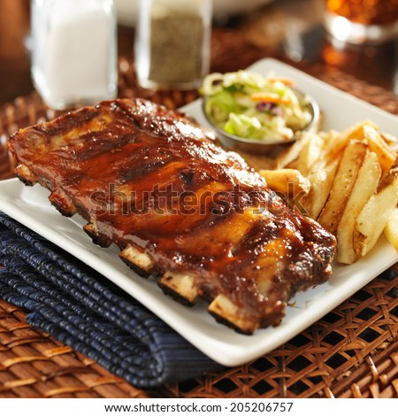 bbq ribs with cole slaw and french fries - stock photo
