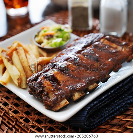 bbq ribs with cole slaw and french fries shot with selective focus - stock photo