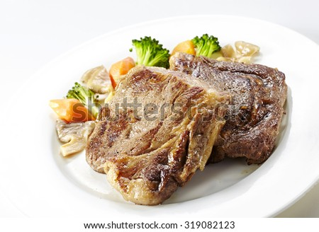 BBQ Steak. Barbecue Grilled Beef Steak Meat with Vegetables. Healthy Food. Barbeque Steak Dinner  - stock photo