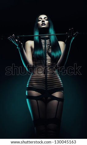 bdsm woman with whip - stock photo