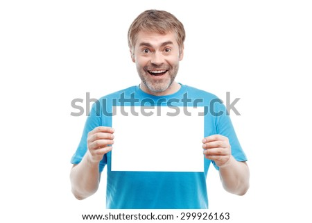 Be cheerful. Positive pleasant adult man holding paper and smiling while evincing joy. - stock photo