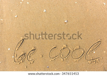 Be cool written on the beach. sand background - stock photo
