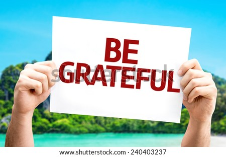 Be Grateful card with a beach on background - stock photo