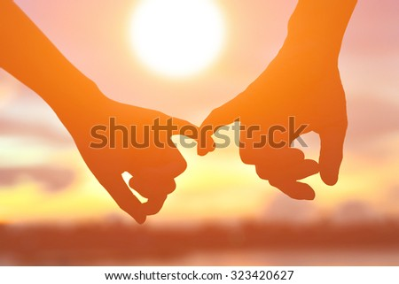 be hand in hand on sunset - stock photo