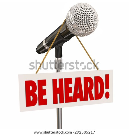 Be Heard words on a sign hanging on a microphone to illustrate sharing an opinion or viewpoint through public speaking in an open forum - stock photo