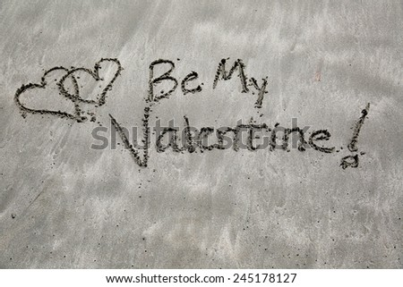 Be my valentine , written messages in the sand at the beach  - stock photo