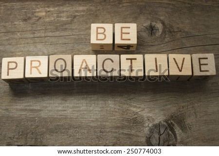 be proactive text on a wooden background - stock photo