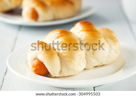 be tasty sausage bread on plate - stock photo