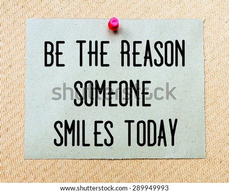 Be The Reason Someone Smiles Today  written on paper note pinned with red thumbtack on wooden board. Happiness conceptual Image - stock photo