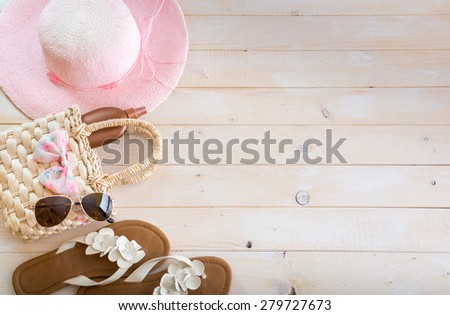 beach accessories on a white wooden background - stock photo