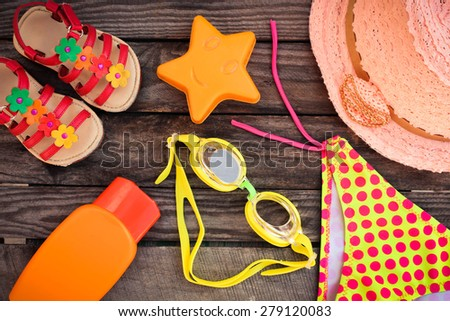 beach accessories on the old wooden background. Toned image.  - stock photo