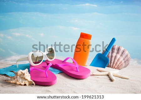 Beach accessories with sand - stock photo