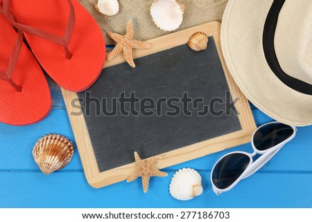 Beach accessory in summer on vacation with shells, hat, copyspace - stock photo