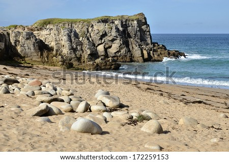 Beach and cliff on the rocky wild coast of the peninsula of Quiberon in the Morbihan department in Brittany in north western France - stock photo