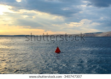 Beach and cloudy sky at sunset with seawater - stock photo