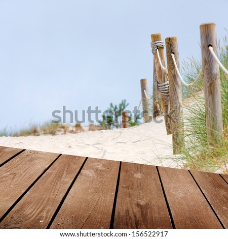 Beach and empty wooden deck table. Ready for product montage display.  - stock photo