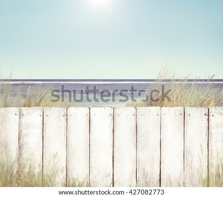 Beach and Fence - stock photo