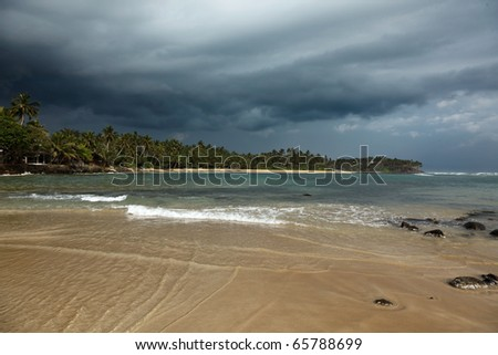 Beach and gathering storm. Mirirssa, Sri Lanka - stock photo
