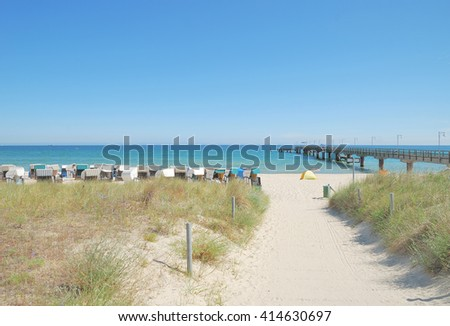Beach and Pier of Goehren on Ruegen Island at Baltic Sea,Mecklenburg western Pomerania,Germany - stock photo